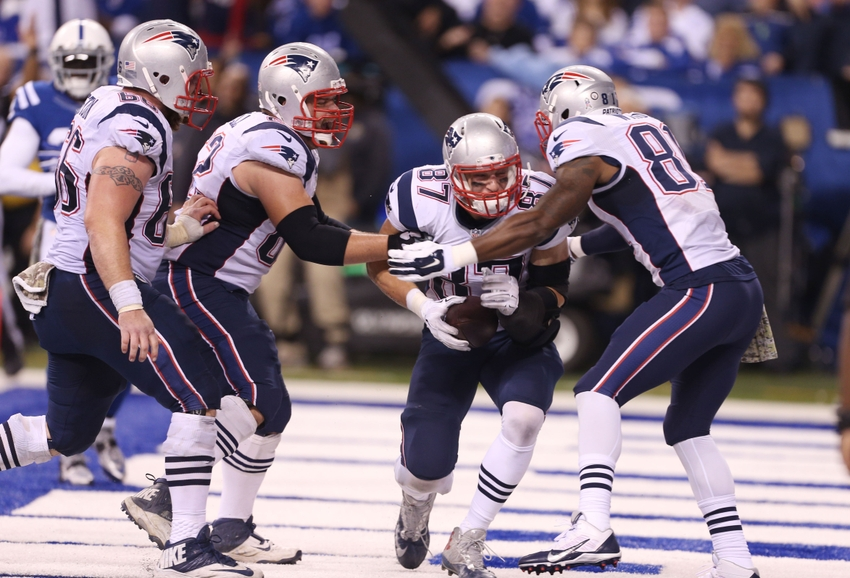 e320c55370e Nov 16, 2014; Indianapolis, IN, USA; New England Patriots tight end Rob  Gronkowski (87) is congratulated by his teammates after scoring a touchdown  against ...
